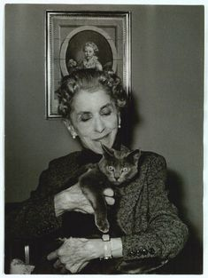 "Karen Blixen and a cat. ""A great artist is never poor"". ""All sorrows can be borne if you put them into a story or tell a story about them"". Karen Blixen, Crazy Cat Lady, Crazy Cats, I Love Cats, Cool Cats, Patricia Highsmith, Celebrities With Cats, Celebs, Michel De Montaigne"