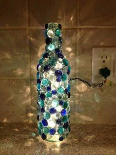 Image 4 of 17 from gallery of Cool DIY Bottle Lamp Ideas To Add Unique Home Decor. This diy glass bead wine bottle lamp is can add glowing effect to any room Glass Bottle Crafts, Wine Bottle Art, Lighted Wine Bottles, Bottle Lights, Decorating Wine Bottles, Glass Bead Crafts, Crafts With Wine Bottles, Glass Beads, Bead Bottle