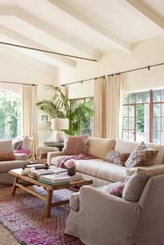 "Living room with pink accents; Reese Witherspoon's house in the movie ""Home Again"""