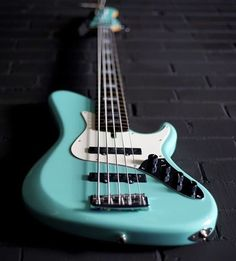 A Pavel Single Cut Jazz Series Bass with a matching seafoam headstock. #bassporn #instabass #bassgram #bassplayer #bassplayermag