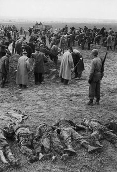 German civilians being forced to bury the dead of the concentration camp at Gardelegen Location:Gardelegen, Germany Date taken:April 1945