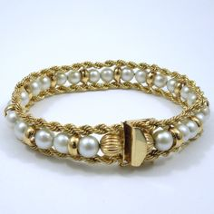 Pearl Bracelet with a 14K Yellow Gold Rope Chain Border and Spacers. - $750