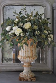 roses & eucalyptus in cream iron urn- very pretty and uses the same flowers you already have from your garden