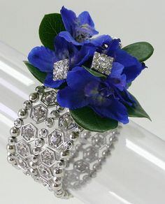 """Royal blue corsage on the """"Monique"""" Bracelet. This New WOW bracelet from Fitz has been a strong seller this spring! It's looking like the prom girls are definitely going for bling! Order Monique here: http://www.pioneerwholesaleco.com/weddings-events/fitz-design-corsage-bracelets/rhinestone-bracelets/monique-corsage-bracelet-limited-edition"""