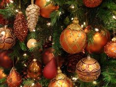 christmas tree decorating in golden colors