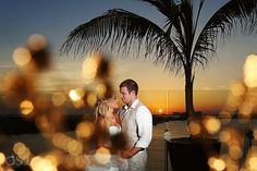 Wedding in Cancun at the Beach Palace Resort. Beautiful newlywed couple in love with a sunset backdrop. Dreamy!  Mexico wedding photographers Del Sol Photography
