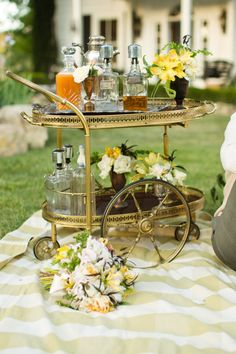 all picnics should be accompanied by a well stocked bar cart  Photography by mikelarson.com, Event Design and Styling by markpadgetteventdesign.com, Floral Design by panaceaflowery.com