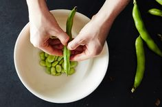 How to Prep Fava Beans on Food52: https://food52.com/blog/10580-how-to-prep-fava-beans