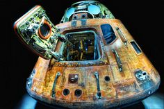 """Apollo 14 Command Module.  This photo is named """"The Life Boat"""" by Photographer William Beem. This is NOT an easy shot, as I've seen this control module up close and personal at Kennedy Space Center in Cape Canaveral, Florida. The room is dark and the spotlight on the control module makes it difficult for even the seasoned photographers. Bravo William Beem for making composing an evocative photo! Easy Shots, Rich Image, Kennedy Space Center, Cape Canaveral, The Life, Apollo, Spotlight, Photographers, Florida"""