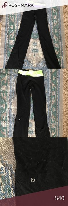 Lulu lemon Leggings Flare lulu leggings. Size 6. Green and purple waist band. lululemon athletica Pants Boot Cut & Flare