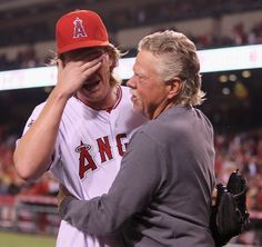 Game #25 5/2/12: Starting pitcher Jered Weaver #36 of the Los Angeles Angels of Anaheim celebrates with his dad Dave after throwing a no-hitter against the Minnesota Twins at Angel Stadium of Anaheim on May 2, 2012 in Anaheim, California. The Angels defeated the Twins 9-0. (Photo by Jeff Gross/Getty Images)