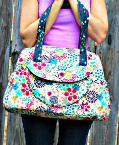 Aragon Bag Sewing Pattern by Sew Sweetness.  This is meant to be a diaper bag patter, but I think it would be cute luggage or an overnight bag.