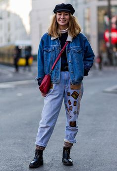 Fashion week attendee nailing double denim in mom jeans with patches, a shearling-lined denim jacket, rounded off with a baker boy cap and combat boots | ASOS Fashion & Beauty Feed
