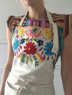 Handmade linen apron with front pockets and adjustable neck strap & adjustable ties Hand embroidered at neckline with Mexican inspired folk embroidery One size Unlined Mexican Embroidery, Folk Embroidery, Embroidery Fashion, Cross Stitch Embroidery, Embroidery Patterns, Patchwork Quilt, Embroidered Clothes, Embroidered Shirts, Linen Apron