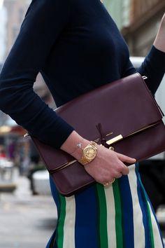 turtleneck + striped skirt + clutch + men's watch by Celine