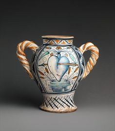 Vase or jar with love motifs Date: ca. 1470–90 Culture: Italian, Deruta Medium: Maiolica (tin-glazed earthenware) Dimensions: Overall (confirmed): H. 10 1/8 x W. 7 1/2 x D. 11 1/4 in. (25.7 x 19.1 x 28.6 cm) Classification: Ceramics-Pottery