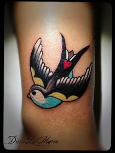 "The heart placement is cool. ""Swallow Old School Tattoo by dariolamarcaink, via Flickr"""