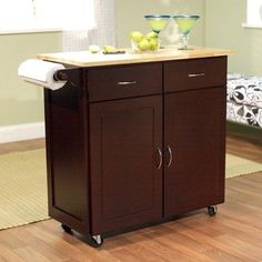 Kitchen Cart Base Finish: Espresso by TMS. $179.00. 60046ESP Base Finish: Espresso Features: -Large kitchen cart.-Natural wood top.-Two utility drawer and storage cabinet with adjustable shelf.-Towel holder on one side. Construction: -Rubber wood and engineered wood construction. Color/Finish: -White Finish. Assembly Instructions: -Assembly required.