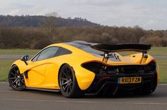 2015 McLaren Is it the advanced engineering - the raw power she contains within beautiful soft fluid curves? The natural roar released when set free to fly? New Sports Cars, Super Sport Cars, Mclaren P1, Gta 4, High End Cars, First Drive, Car In The World, Hot Cars, Car Ins