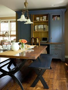 Bench Seating: Try something different in your dining space. Opt for picnic-style benches like these, which were painted blue to match the room¿s decor. Incorporating a bench into your dining room or eating area provides multiple seats and can be tucked under the table when not in use to allow more space to move around the room.
