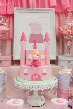 Castle cake at a Peppa Pig birthday party!  See more party planning ideas at CatchMyParty.com!
