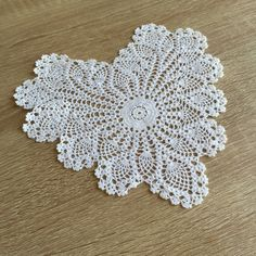 """Set the mood with this romantic heart shape doily. Hand crochet lace with pineapple around the edge. 100% cotton. 8"""" heart. Color: WHITE . Available size 10"""" Heart, 12"""" Heart & 14 Heart. **Due to hand"""