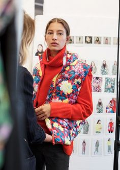 & Other Stories | Inspiration | Floral Print Padded Vest | Slim-Fit Denim Jeans | High Neck Sweater | Mirrored Mesh Earrings
