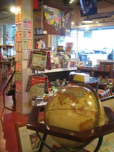 Inside store with a globe and the license plate map.