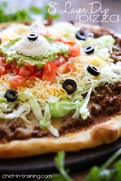 8 Layer Dip Pizza! Everything you LOVE about the crowd-pleasing 7 layer dip now made into a pizza!