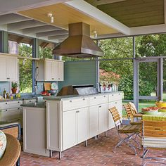Maryland Outdoor Kitchen: The brick-paved floor is pitched slightly in all directions so it can be hosed off as needed. Kitchen cabinets elevated on stainless steel legs let the water wash beneath. -  I would really be able to cook in this kitchen