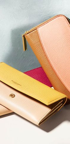 A selection of super-soft wallets in nude, pale crimson and camel hues from Burberry for S/S14  | The House of Beccaria