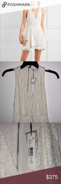 Brand New Alice & Olivia Tanner Beaded dress 0 Brand new with tags! Retail price is $795. This dress is in perfect condition. It was purchased directly from an Alice & Olivia boutique. Comes with extra beading. Size 0. Dress is off white with white, clear and silver beading. The beading pattern is in the shape of flowers. Purchased for my wedding rehearsal dinner but ended up wear something else. Alice + Olivia Dresses
