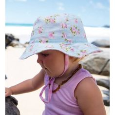 d7cdca05567 New season baby girls cotton hats. Fully reversible with 2 gorgeous styles  in one hat. Toggle chin strap   Buy online today at MikyB!