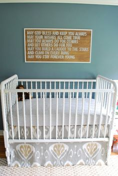 Love this sign and saying above the crib. (Great nursery, too!)