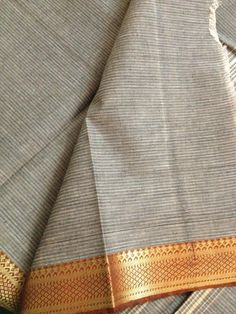 Grey Mangalagiri handloom Saree. The contrast of the quiet grey handloomed ground and the bright gold and red border blows my mind.