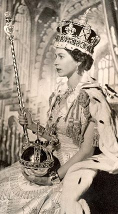 In this Cecil Beaton portrait of Queen Elizabeth II set in the throne room at Buckingham Palace, London, after her coronation in June 1953, the Queen wears the Imperial State Crown and holds the Orb and Septre