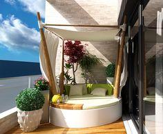 Wenn es in der Wohnung zu heiß wird, kann man das Bett im Schutz des Balkons auch nach draußen verlegen.