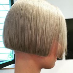Sharp bob haircut, perfect for feminizing a sissy.