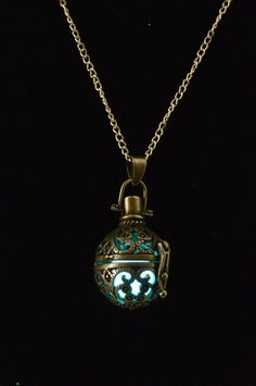 Kaged Kryptonite - Ocean Blue Mysterious Glowing Sphere in Antique- Silver Plated Cage