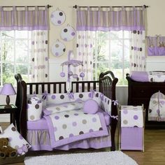 This polka dot themed nine piece baby bedding set was created by Sweet Jojo Designs. This set includes a blanket, crib bumper, crib skirt, fitted sheet, toy bag, decorative throw pillow, diaper stacke