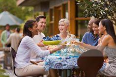 ストックフォト : Multi-ethnic friends toasting at party