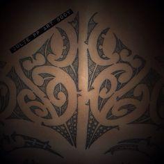 Back detail tattoo Maori ta moko