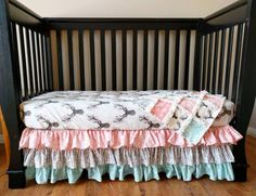 These woodland prints in coral and green are so beautiful and are the perfect addition to a baby girl's nursery! This quilt is done in such pretty, modern colors with beautiful florals, arrows, and deer prints. The back of this quilt will be done in minky, which is so perfect for snuggling!  **
