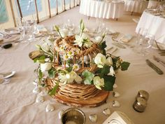 One of the Cornish Lobster pots filled with flowers on a guests table