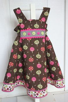 """Fall- Tree Feliz dress    Pattern is Feliz, which is now available in the book """"Sewing clothes Kids Love"""" by Landon and Pollehn(lovely book!). Fabric Finders mod twill dots #596, Tree print #928, and 1/16"""" chocolate checks"""