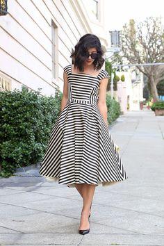Dress: Katie Ermilio via The RealReal ; Shoes: Christian Louboutin ; Sunglasses: Celine; Clutch: Kate Spade...