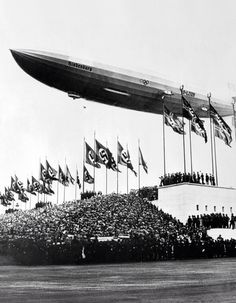 The Hindenburg passing at low altitude over the Zeppelinfeld, in Nuremberg. Notice the Olympic Rings on the side: the Airship flew for the first time in March 1936, when the XI Olympiad was at hand.