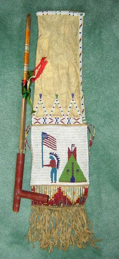 Beautiful Yankton Sioux pipe bag with exquisite beading and detail. Quill and beading are original, late 1800's. Pipestone pipe. Deerskin and fringe.