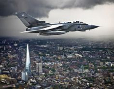 A RAF Tornado from II (AC) Squadron, RAF Marham, flys over the Shard skyscraper building in London during Her Majesty the Queen's 2013 Birth...