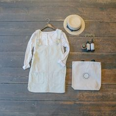 Two Pocket Detail Dungaree Dress and Slit Neckline Stripe Tee with Bow Detail Straw Hat: www.oliveclothing.com